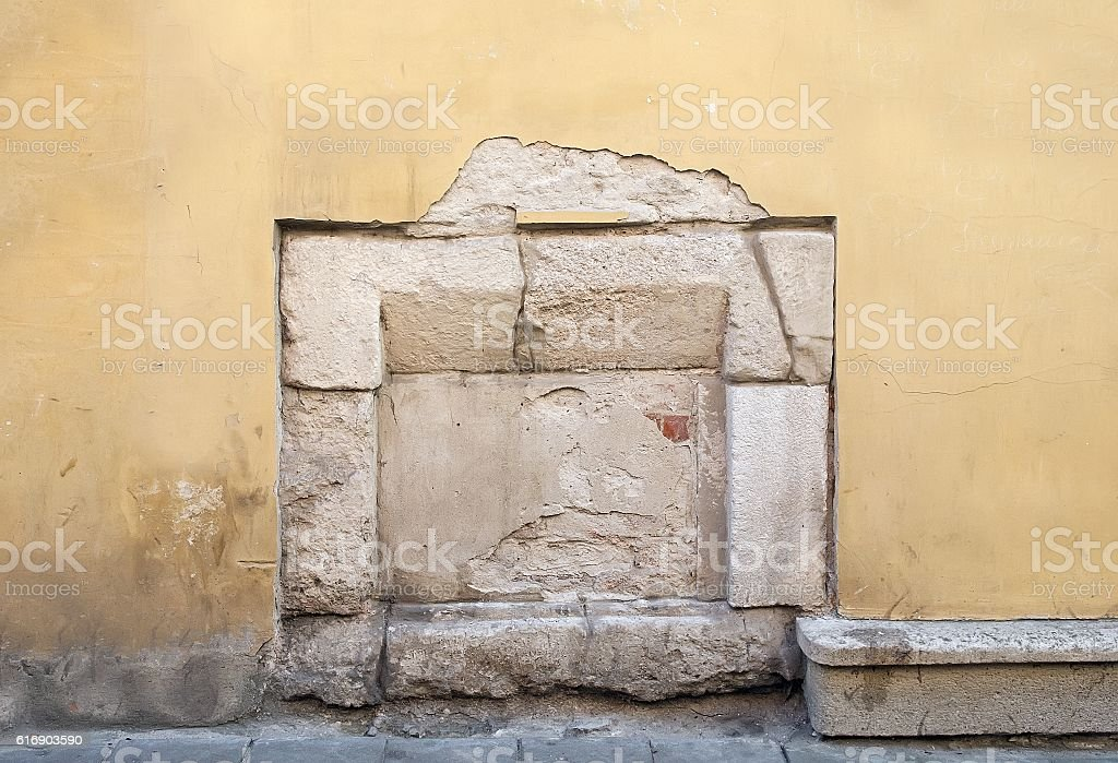 Old building wall with immured window stock photo
