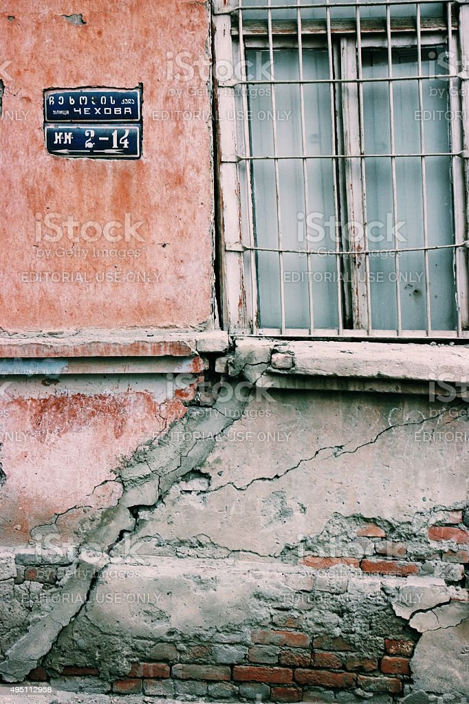 Old building with crumbling facade in Tbilisi, Georgia stock photo