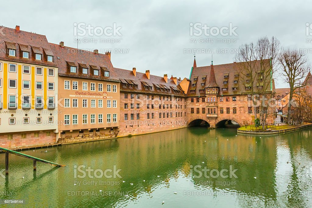Old buildings and arch bridge reflected in water. Nuremberg, Bavaria stock photo