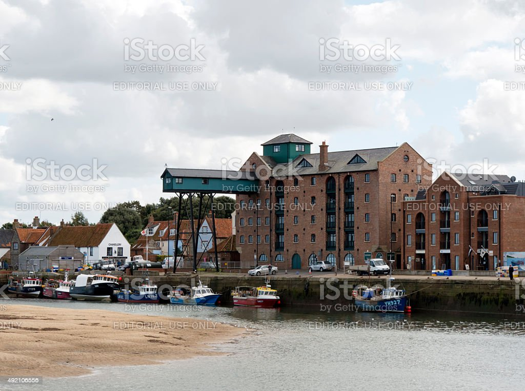 Old buildings and boats at Wells-next-the-Sea stock photo