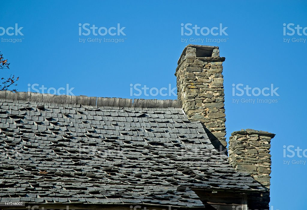 Old Bumpy Roof and Two Chimneys royalty-free stock photo