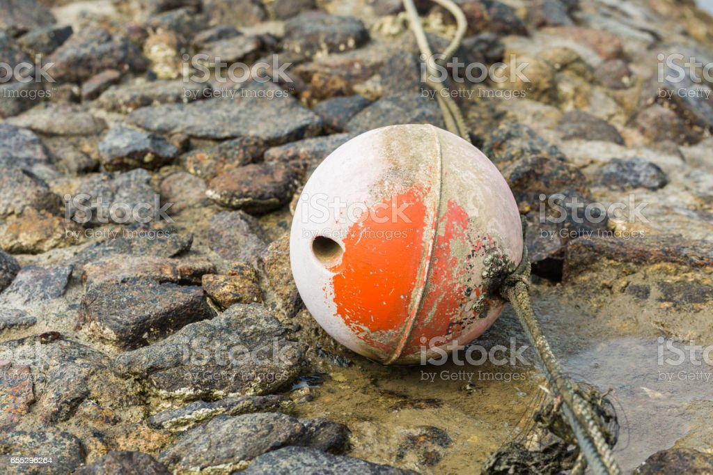 Old buoy on bubble in the coastal area stock photo