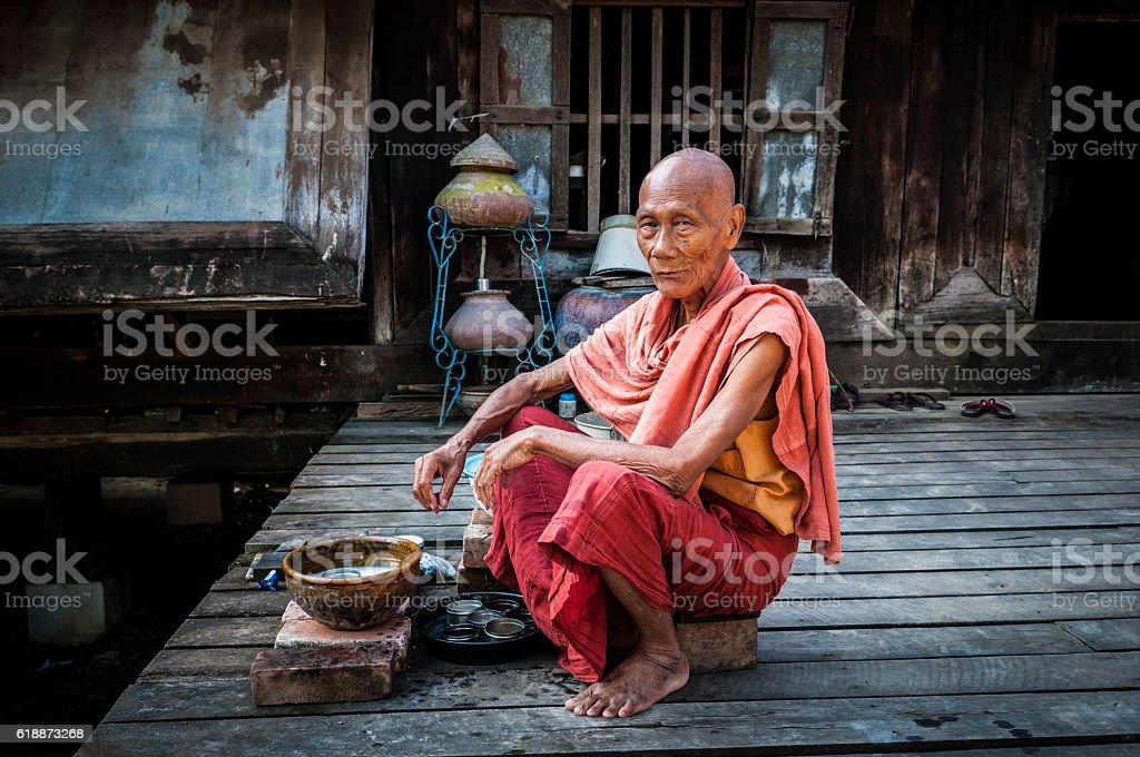 Old Burmese monk in Mandalay, Myanmar stock photo
