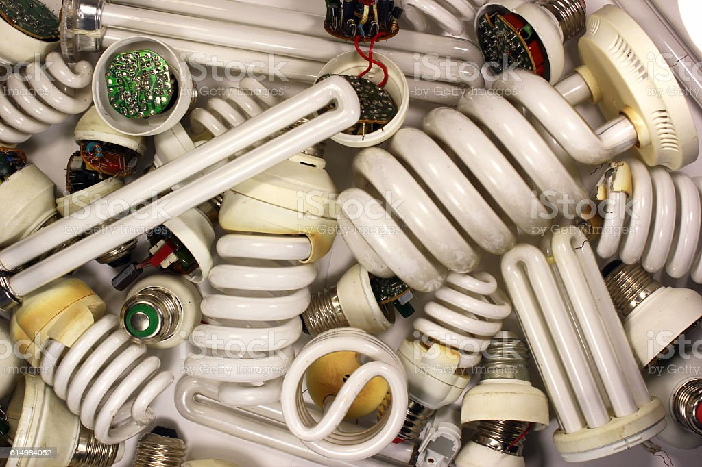 Old burnt fluorescent energy saving lamps. stock photo