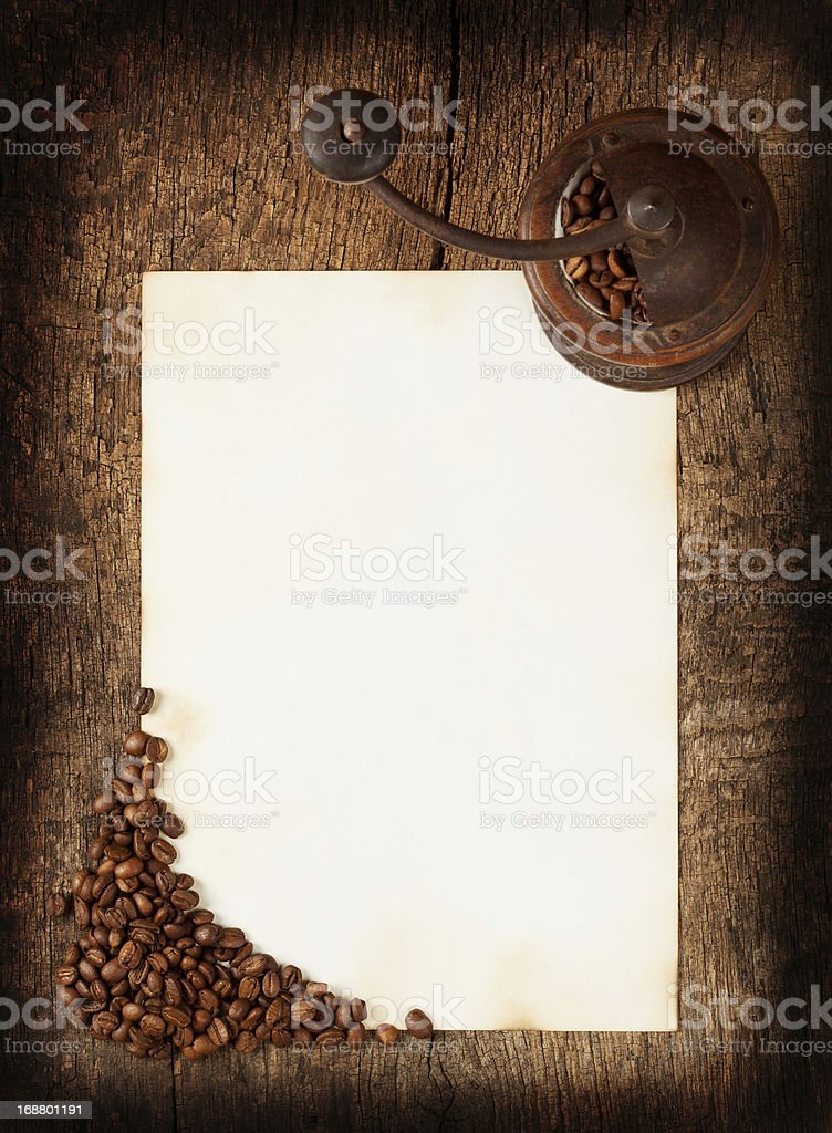Old burnt sheet with a coffee grinder royalty-free stock photo