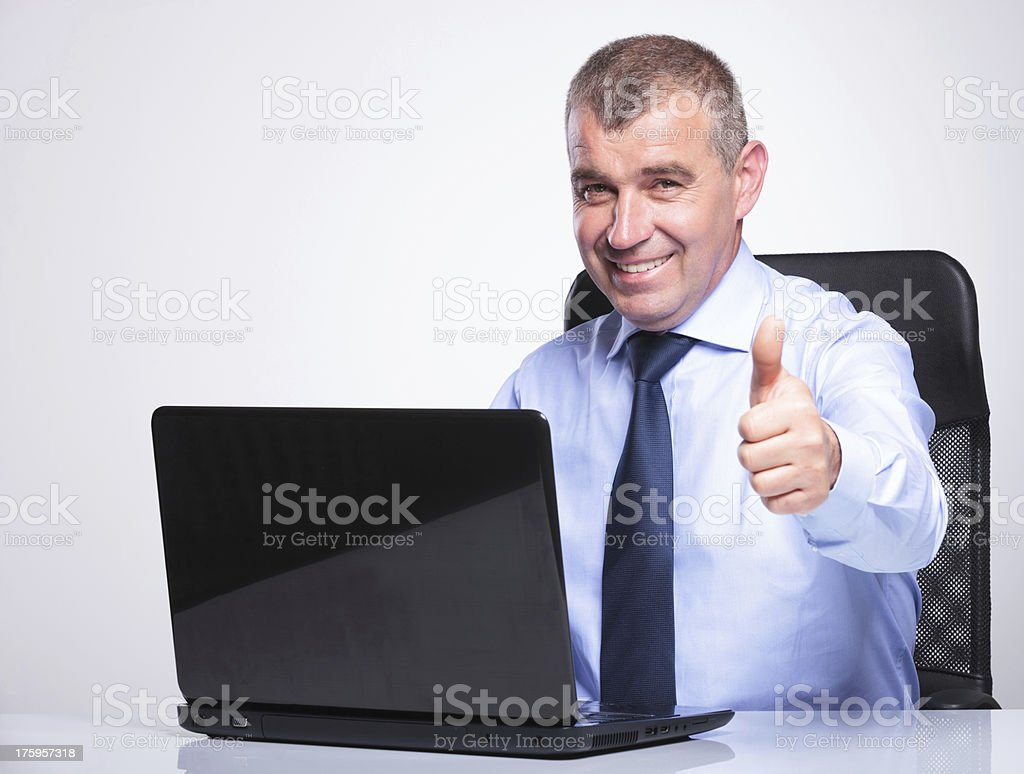 old business man showing thumbs up from desk royalty-free stock photo