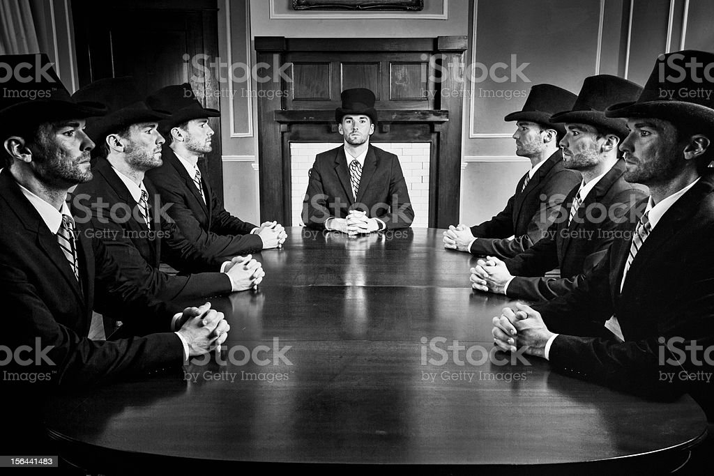Old businessman clones stock photo