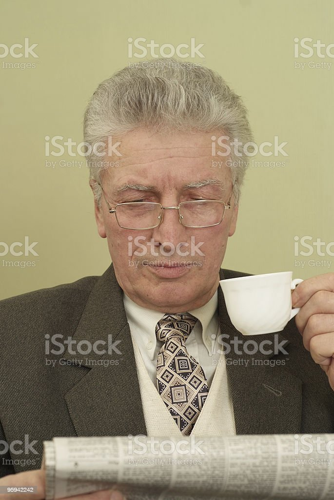 old businessman  looks to the newspaper royalty-free stock photo