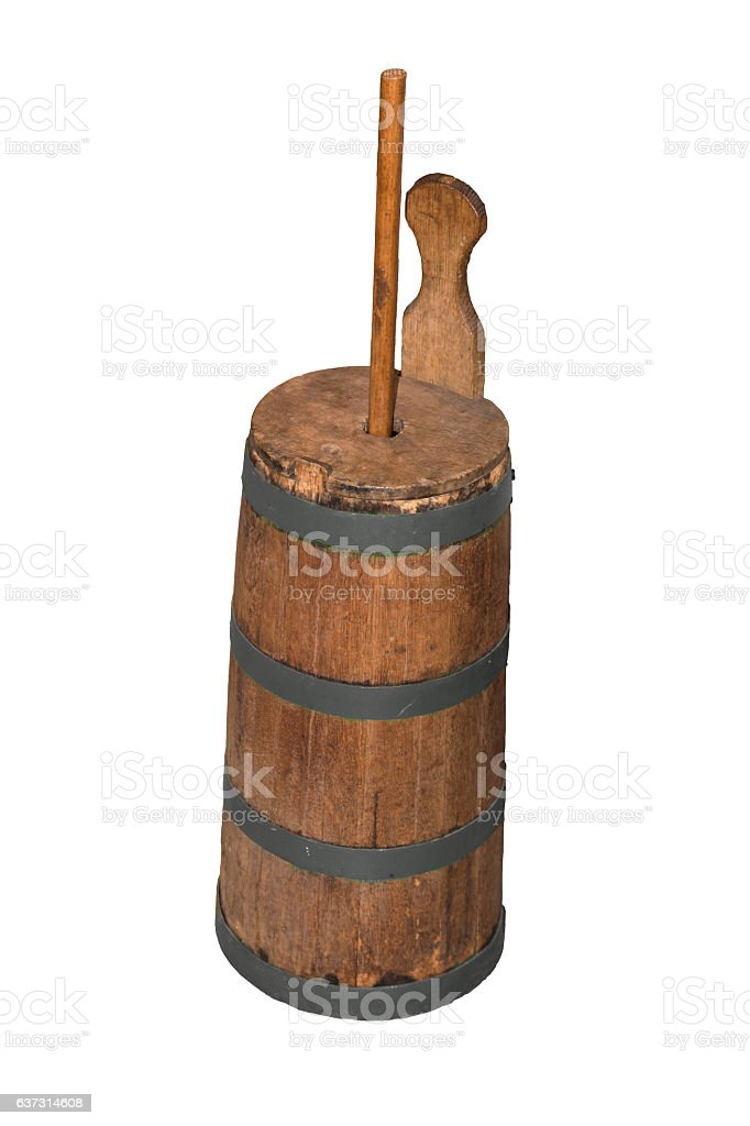 Old butter churn on a white background stock photo