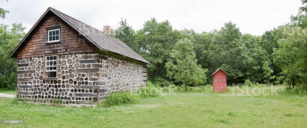 Old Cabin and Outhouse royalty-free stock photo