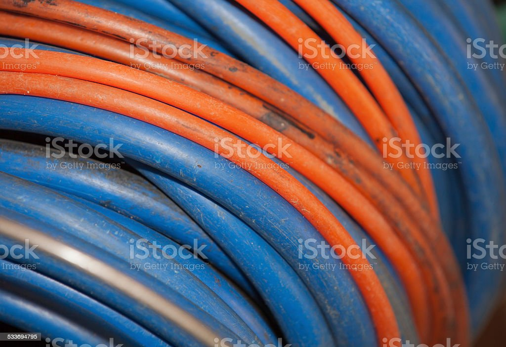 Old cable reel in Blue and orange stock photo