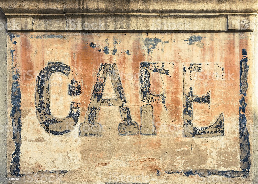 Old cafe sign on a wall in France stock photo