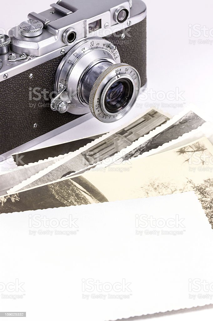 Old camera and photos stock photo