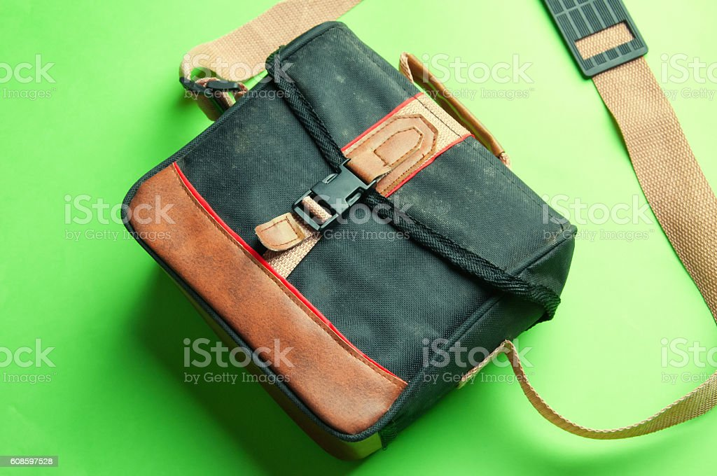 Old camera bag on a green background stock photo