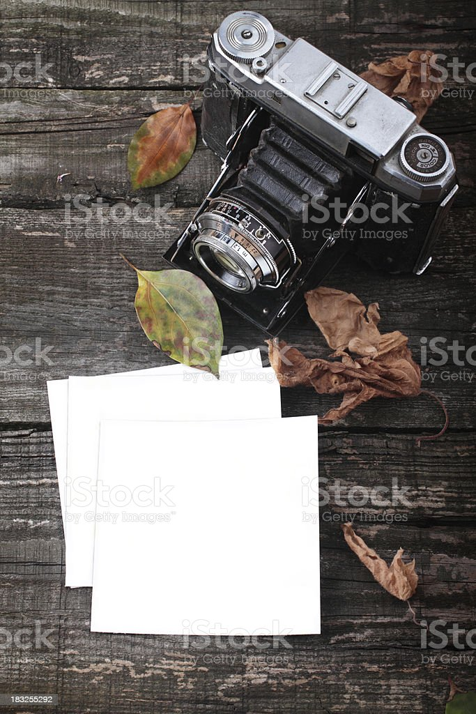 Old camera & Blank Photopaper stock photo