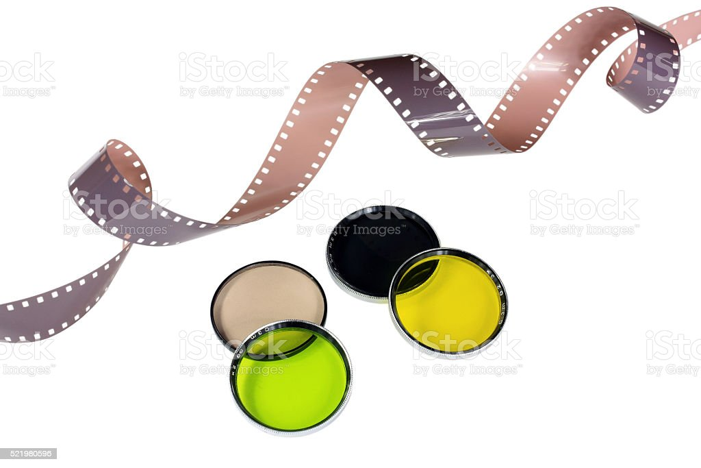 Old camera film and filters stock photo