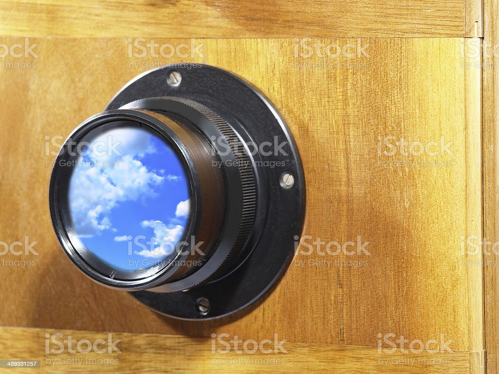 Old camera lens with blue reflection. royalty-free stock photo