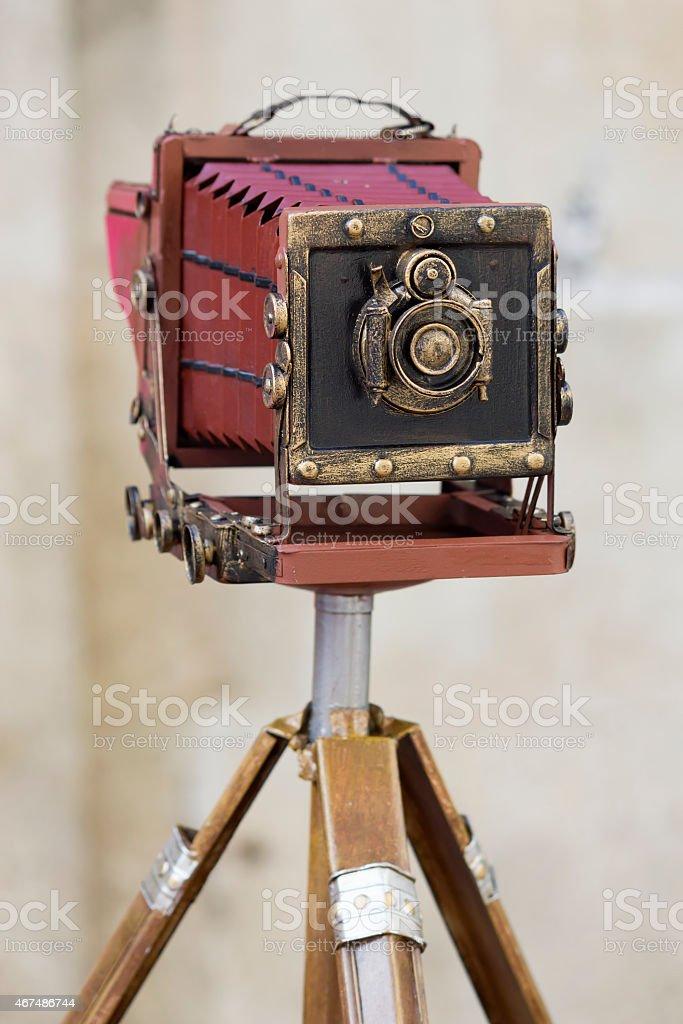 Old camera on a tripod stock photo