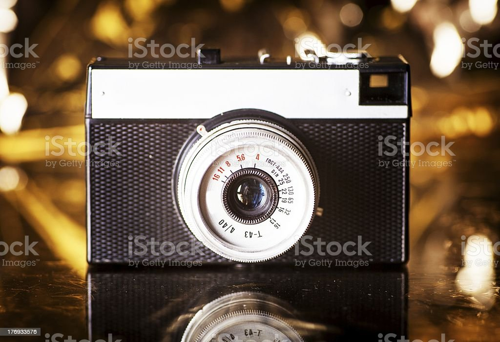 Old camera on gold background royalty-free stock photo