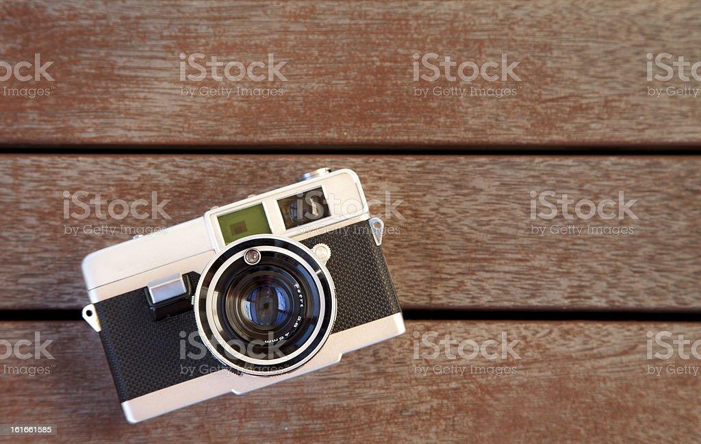 Old camera on wood stock photo
