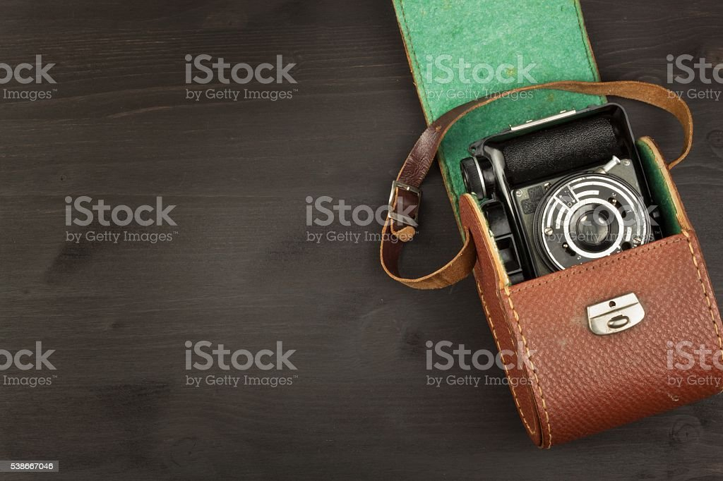 Old camera on wooden table. stock photo