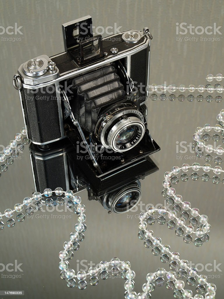 Old camera with jewelry royalty-free stock photo