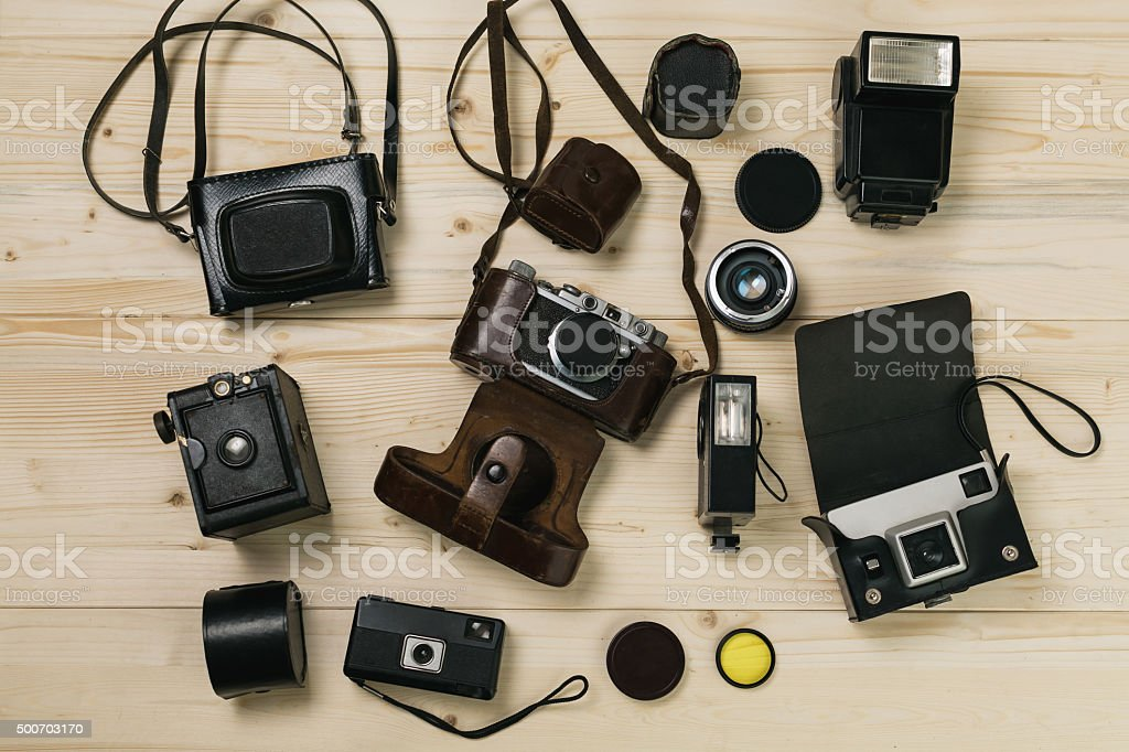 Old cameras on wooden table stock photo