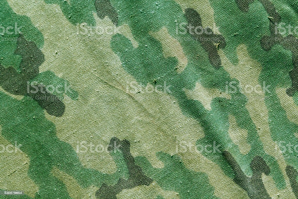 Old camouflage cloth texture. stock photo