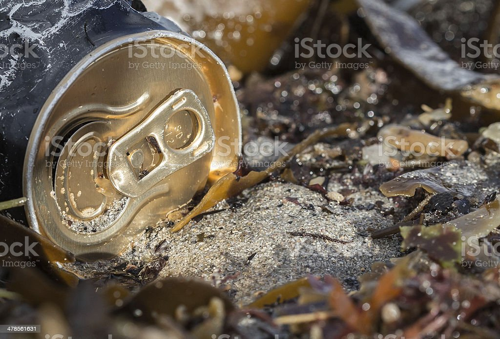 Old can on beach royalty-free stock photo