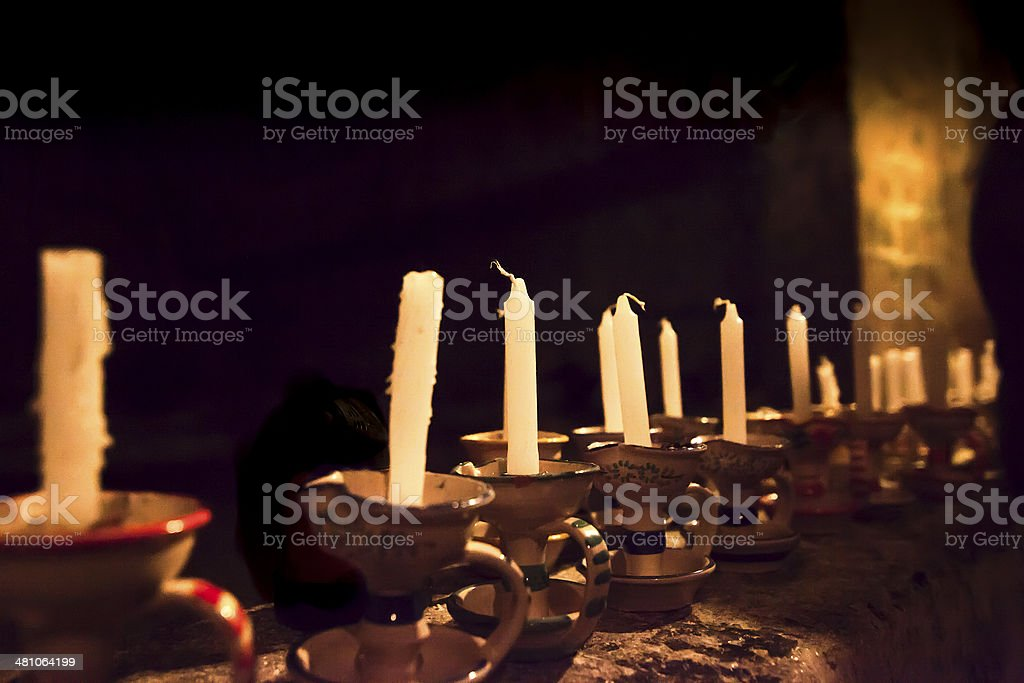 old candles in a dark church royalty-free stock photo