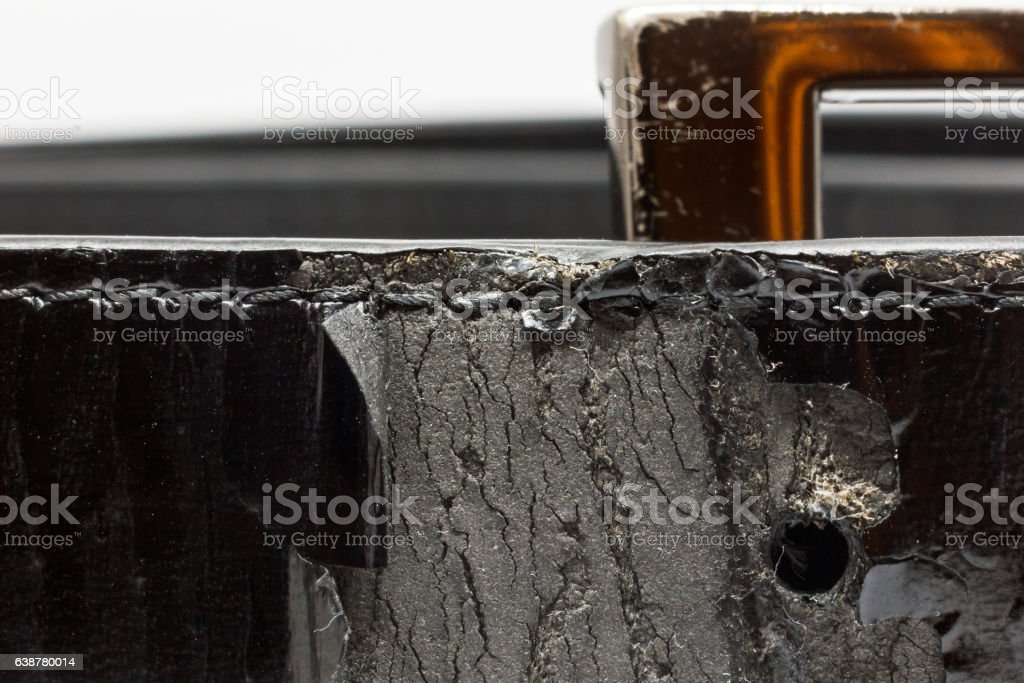 Old canker leather black belt. stock photo