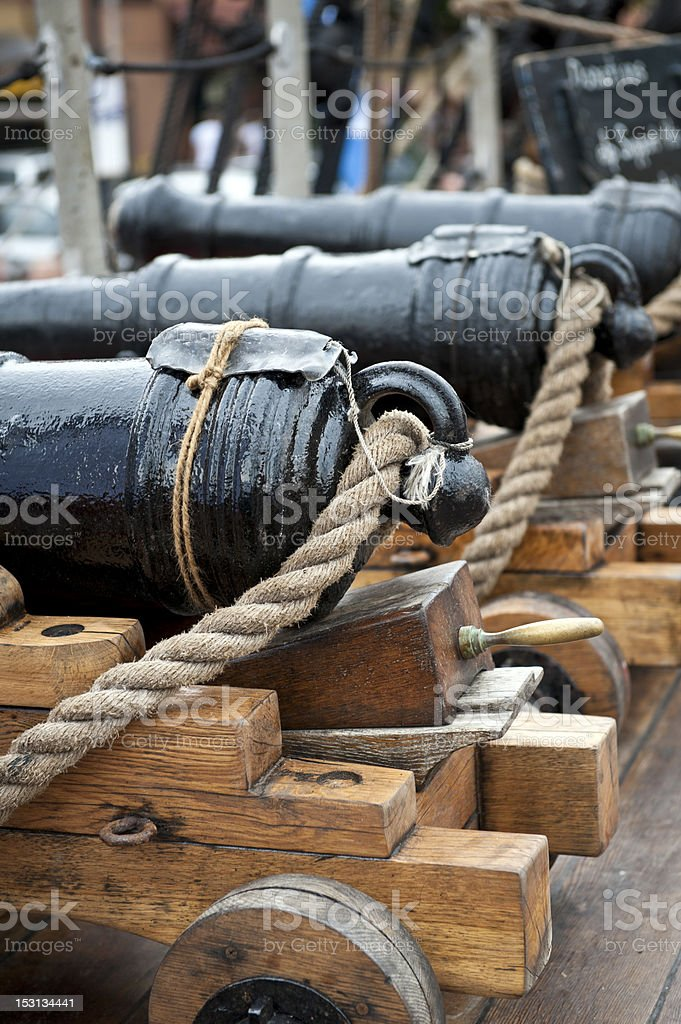 Old cannon on the ship stock photo
