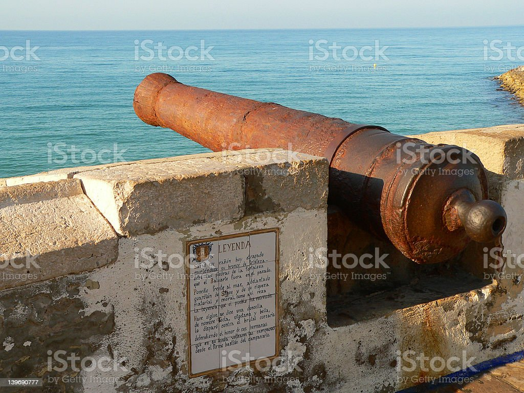 Old cannon overlooking Mediterannean Sea in Sitges (Spain) stock photo