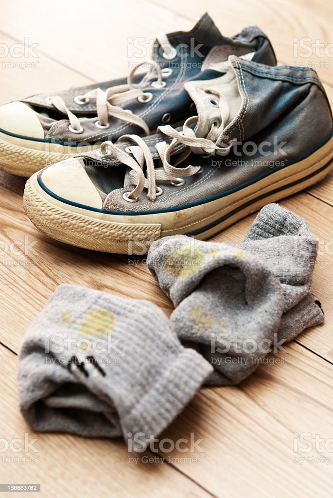 Old canvas lace up shoes with dirty socks stock photo