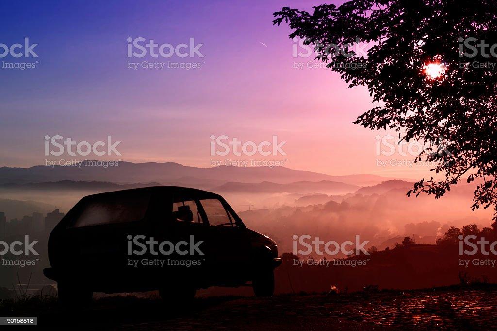Old car and sunrise stock photo