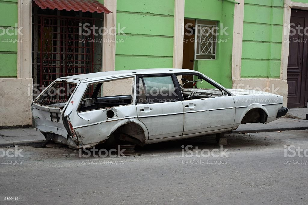 Old car dying on the street stock photo