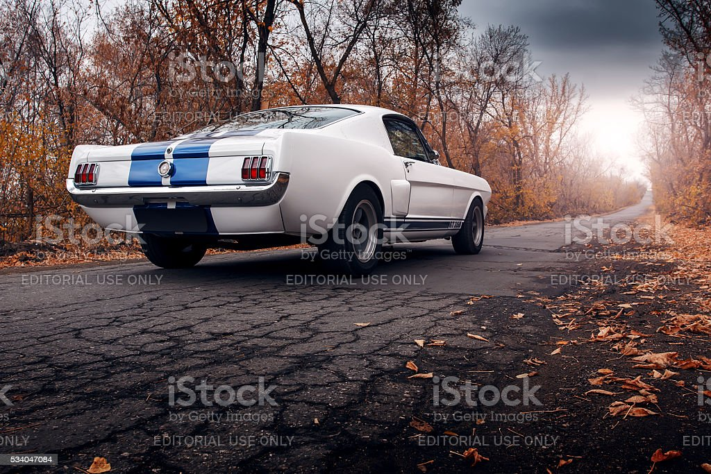 Old car Ford Mustang Shelby GT350 on the road stock photo