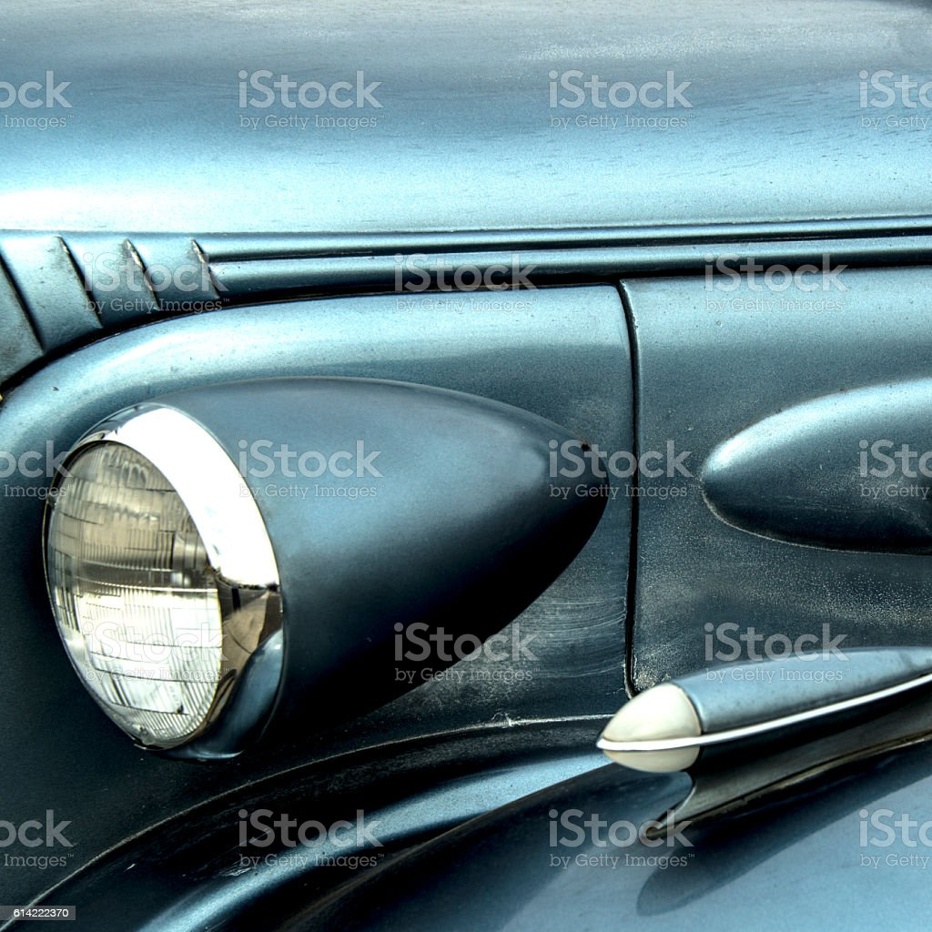 Old Car Headlight Detail, Blue-gray and Chrome, Specular Highlights stock photo