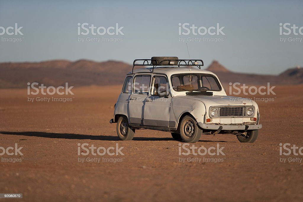 Old car in a desert stock photo