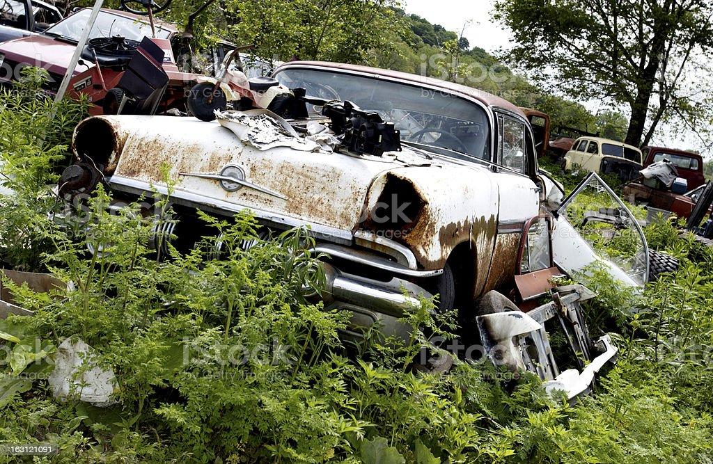 Old car in junkyard royalty-free stock photo