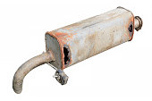 Old car muffler. Front and corrosion damage.