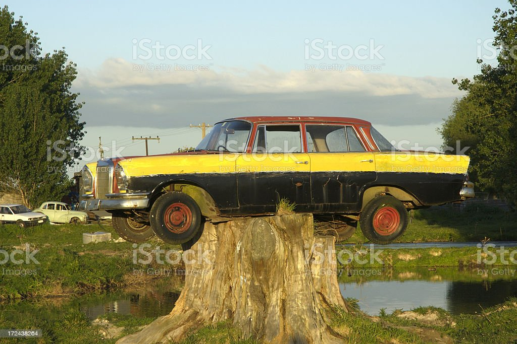 Old Car on a tree stump royalty-free stock photo