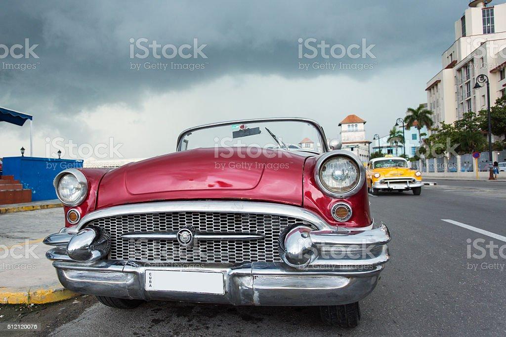 Old car on street of Havana, Cuba on the rain stock photo