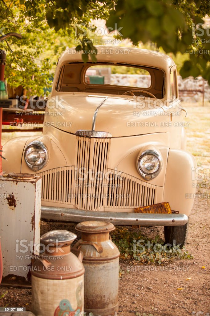 Antique Studebaker car at an abandoned filling station. Studebaker...