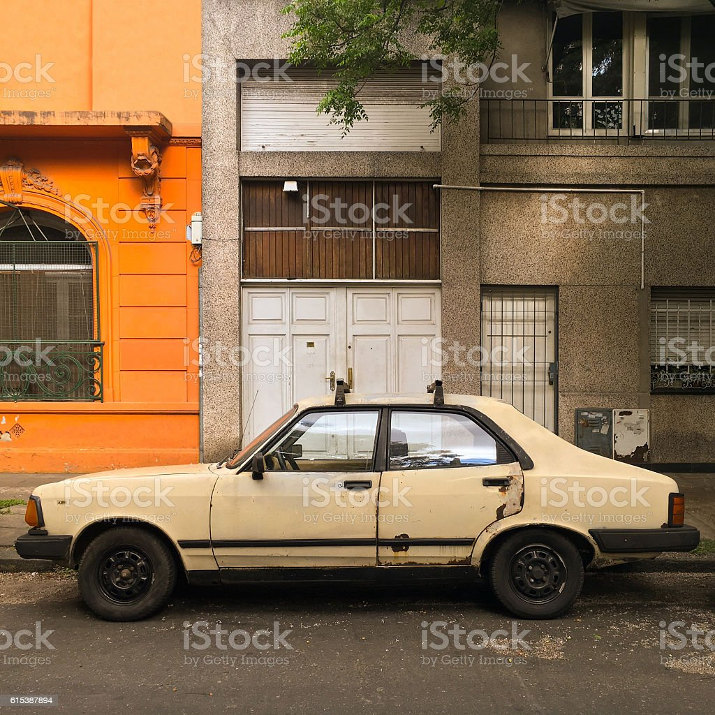 Old car parked in the street stock photo