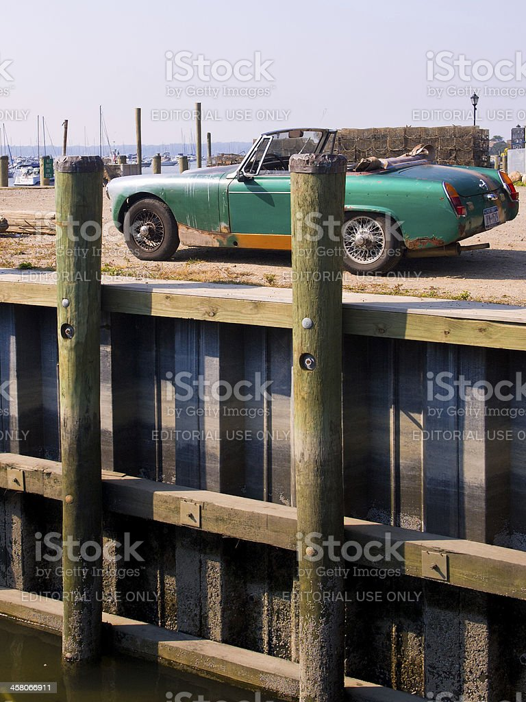 'Old Car Parked on Pier at East Northport Village, NY' stock photo