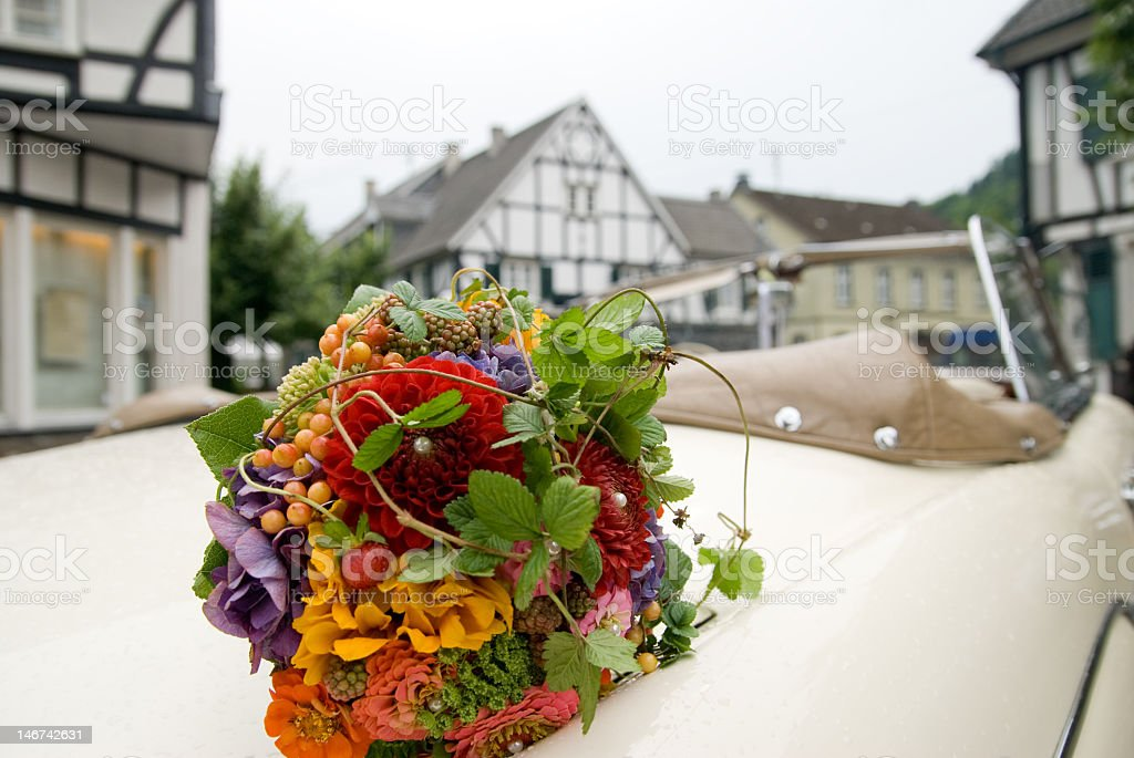 Old car with bunch of flowers royalty-free stock photo