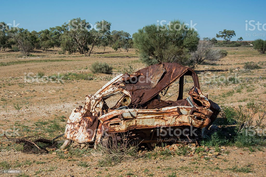 Old car wreck in the middle of the outback of Australia stock photo