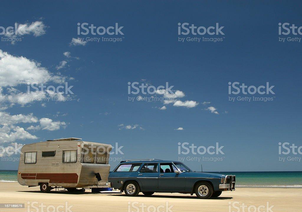 Old caravan & car on beach royalty-free stock photo