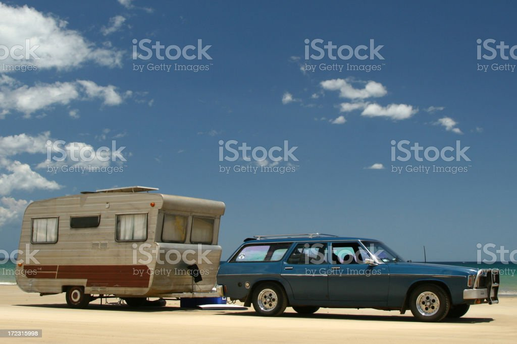 Old Caravan & car on beach stock photo